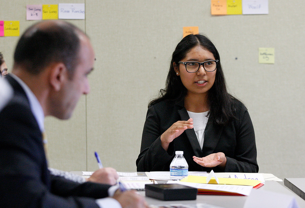 . Gonzales High School ninth grader Andrea Garcia, 14, talks to Congressman Jimmy Panetta during his visit to school to meet with students who participating in the Wings of Knowledge (WOK) program on Monday, April 2, 2018.  Students discussed the project they have been working on in collaboration with the National Oceanic and Atmospheric Administration (NOAA) and share a prototype of a system they developed to gather weather data for NOAA.  (Vern Fisher - Monterey Herald)