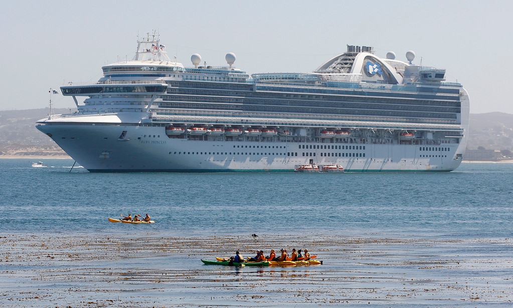 . The cruise ship Ruby Princess at anchor outside the Monterey Harbor on Tuesday, April 3, 2018.  (Vern Fisher - Monterey Herald)