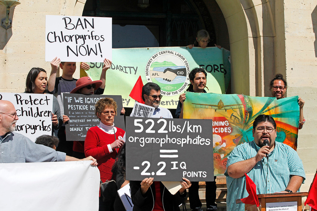 . Cesar Lara, executive director, Monterey Bay Central Labor Council (right) speaks at a protest of the farmworking community that is demanding that Governor Brown step up to enact a statewide ban of the brain-harming organophosphate pesticide chlorpyrifos at the old Monterey County Jail in Salinas on Friday, March 31, 2017.   (Vern Fisher - Monterey Herald)