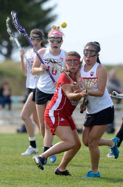 . Carmel\'s Serena Valdez Klemek, left, crashes into York\'s Suzanna Hoffman while chasing a loose ball during lacrosse at York School in Monterey on Wednesday April 5, 2017. (David Royal - Monterey Herald)