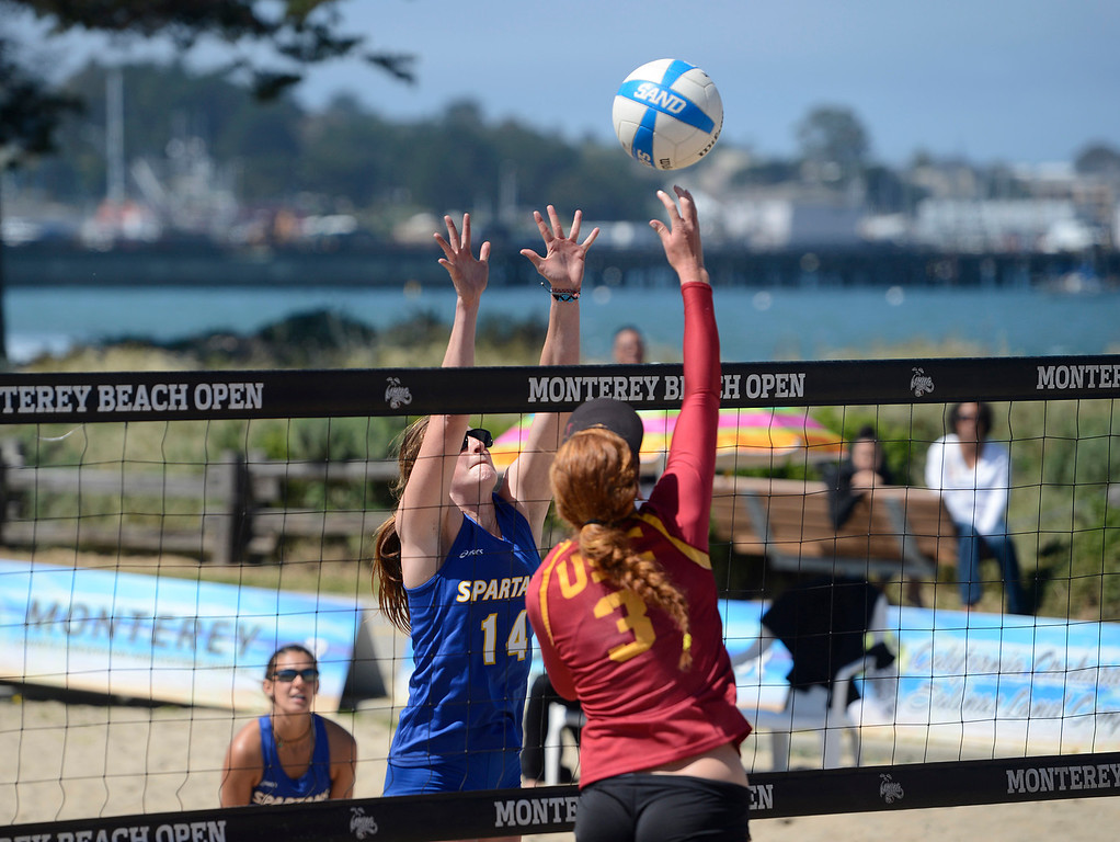 . USC\'s Kelly Claes hits the ball across the net against San Jose State\'s Alli Mehan during the number one match during the second annual Monterey College Invitational beach volleyball tournament at Window on the Bay Park in Monterey on Sunday April 2, 2017. Claes and teammate Sara Hughes were 96-0 before winning the match. (David Royal - Monterey Herald)