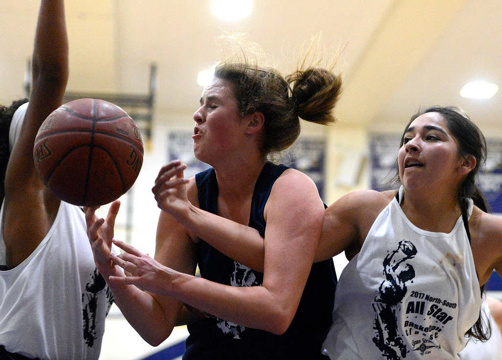 . Scott\'s Valley\'s Sam Boyle, left, battles North Monterey County\'s Amanda Torrez for a loose ball during the girls 10th annual North-South All-Star Basketball Classic at Everett Alvarez High School in Salinas on Friday March 31, 2017. (David Royal - Monterey Herald)