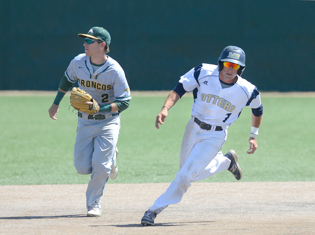 . CSU Monterey Bay\'s Zakry Taylor rounds second base past Cal Poly Pomona\'s Bryce Graddy during baseball at CSUMB in Seaside on Saturday April 1, 2017. The Otters won the game 3-1. (David Royal - Monterey Herald)