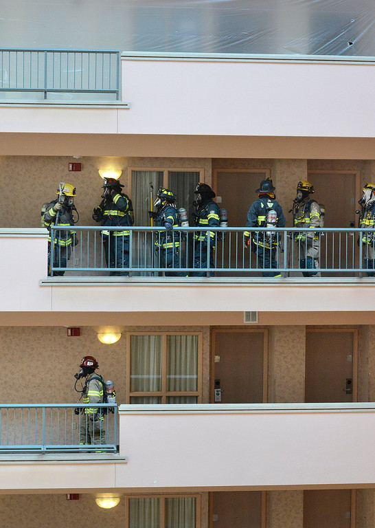 . Firefighters work on the seventh and eighth floors inside the during a high rise fire training exercise in Seaside on Sunday April 2, 2017. The event, which was hosted by Seaside Fire, was attended by fire units from Monterey, marina, Calfire, North County, AMR and Monterey County Regional Fire. (David Royal - Monterey Herald)