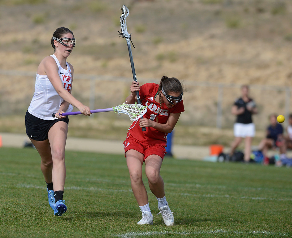 . York\'s Audrey Bailey scores a goal past Carmel\'s Emma Crabbe during lacrosse at York School in Monterey on Wednesday April 5, 2017. (David Royal - Monterey Herald)