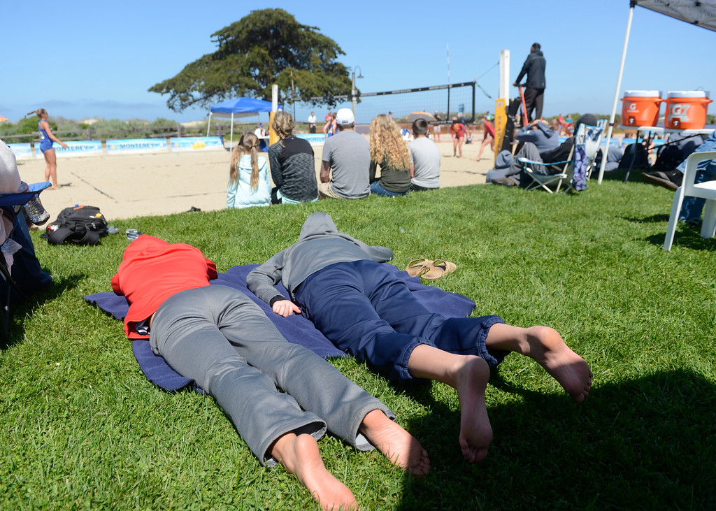 . Volleyball fans nap and take in the action during the second annual Monterey College Invitational beach volleyball tournament at Window on the Bay Park in Monterey on Sunday April 2, 2017. (David Royal - Monterey Herald)