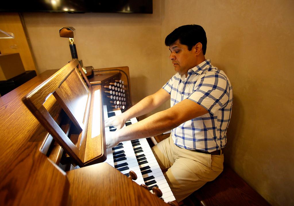 . Ronald Paul Sidhu plays the oprgan at Carmel Presbyterian Church on Thursday, April 6, 2017.  (Vern Fisher - Monterey Herald)