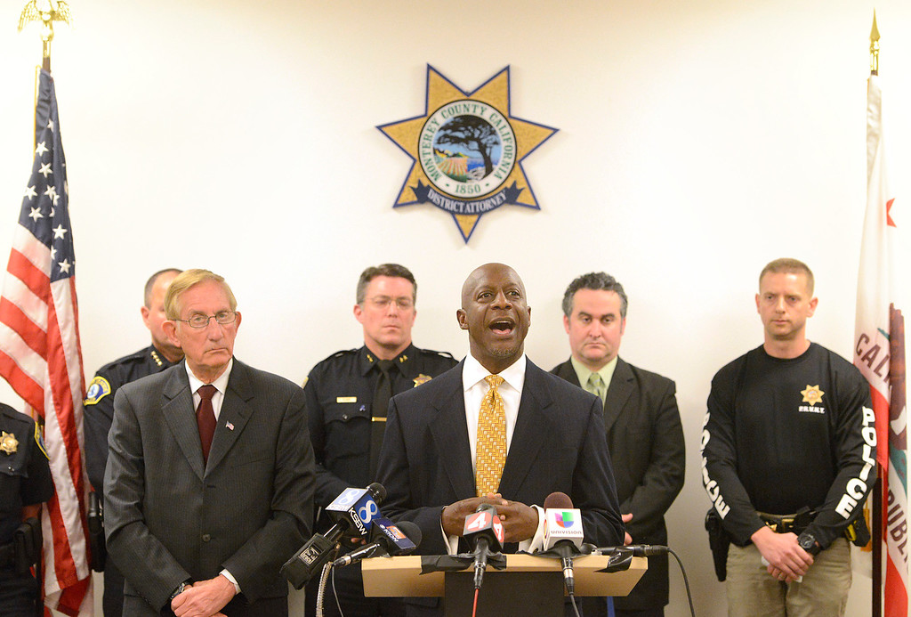 . Bertram Fairries, FBI assistant special agent in charge of the bureau�s San Francisco field office speaks beside Monterey County District Attorney Dean Flippo, left, and members of county law enforcement leadership while announcing that Charles Allen Holifield with be charged in the 1998 kidnapping and murder of Christina Williams during a press conference at the Monterey County Government Center in Salinas on Thursday April 6, 2017. Holifield is currently serving time in a California prison. (David Royal - Monterey Herald)