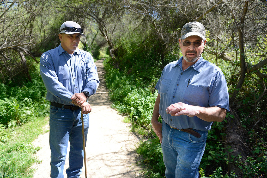 . Northern Salinas Valley Mosquito Abatement District vector control technician Jeff Johnson, right, speaks about the wet winter beside vector control technician Paul Palomo at the Frog Pond in Del Rey Oaks on Friday March 31, 2017.