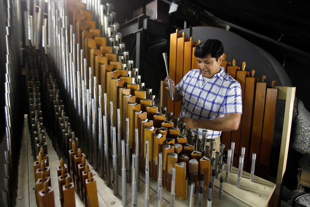 . Ronald Paul Sidhu in the chambers room working on the new organ at Carmel Presbyterian Church on Thursday, April 6, 2017.  (Vern Fisher - Monterey Herald)
