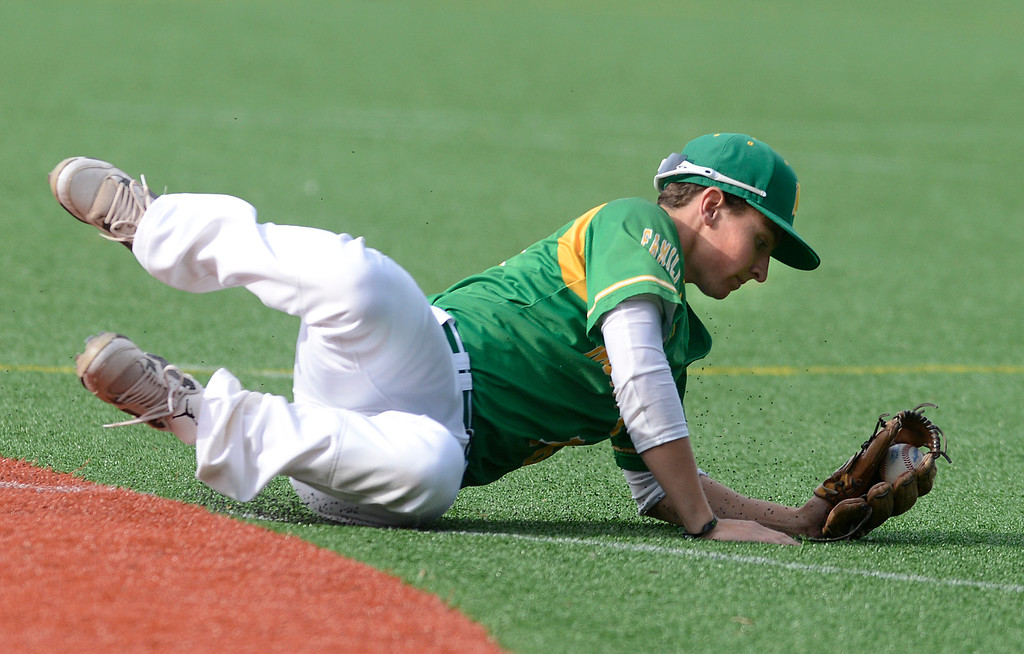 . Monterey second baseman Michael Carnazzo dives for an infield hit during baseball against Monte Vista Christian at Sollecito Park in Monterey on Tuesday April 4, 2017. (David Royal - Monterey Herald)