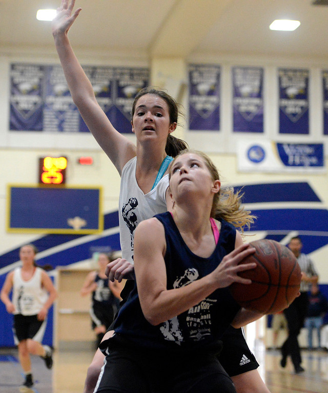 . Santa Cruz\'s Maddy Miller looks for a shot under Gilroy\'s Maddie Cox during the 10th annual North-South All-Star Basketball Classic at Everett Alvarez High School in Salinas on Friday March 31, 2017. (David Royal - Monterey Herald)
