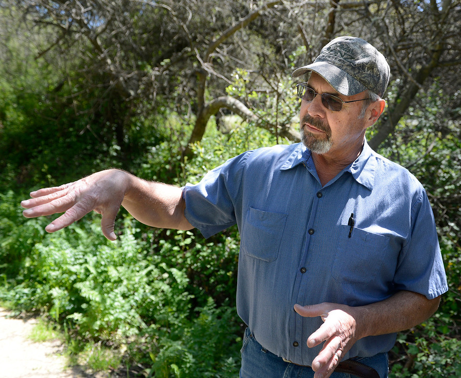 . Northern Salinas Valley Mosquito Abatement District vector control technician Jeff Johnson speaks about the wet winter at the Frog Pond in Del Rey Oaks on Friday March 31, 2017.