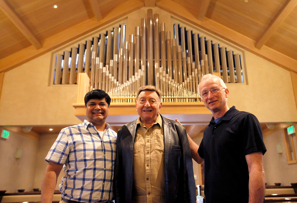 . Ronald Paul Sidhu, Sal Di Mercurio and Frans Bosman in front of the new organ at Carmel Presbyterian Church on Thursday, April 6, 2017.  (Vern Fisher - Monterey Herald)