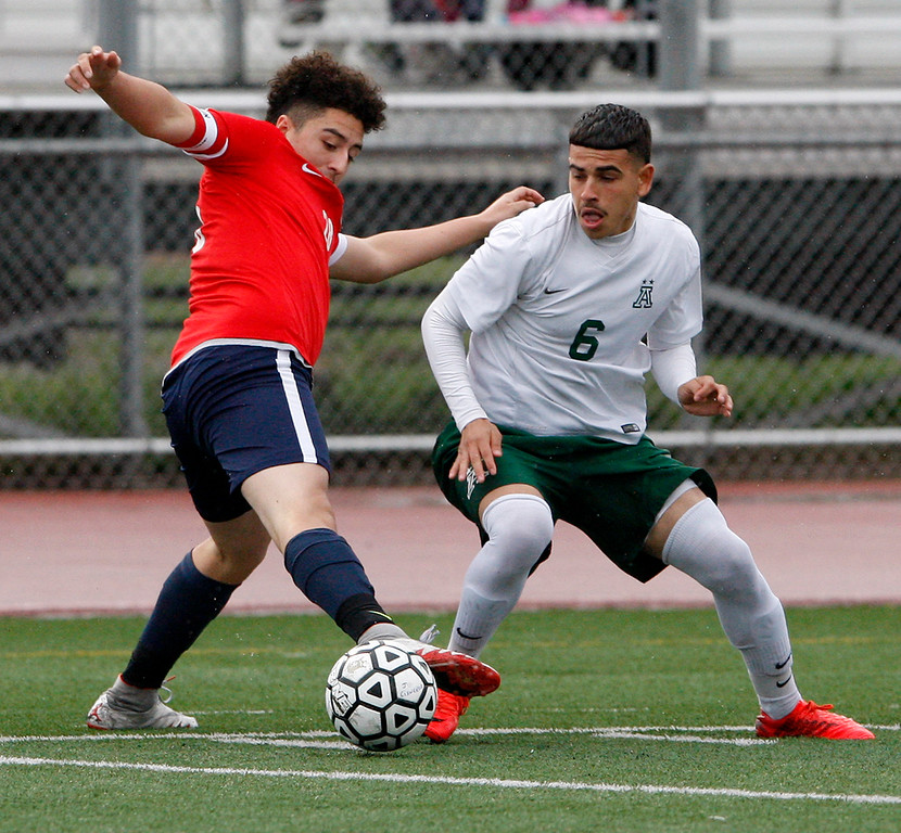 . Richmond High School\'s Manuel Nava (28) battles Alisal High School\'s Angel Amezcua (6) during their CIF Nor Cal DII Championship match in Salinas on Saturday, March 10, 2018.  Alisal went on to win the Nor Cal DII boys soccer title 3-1.  (Vern Fisher - Monterey Herald)