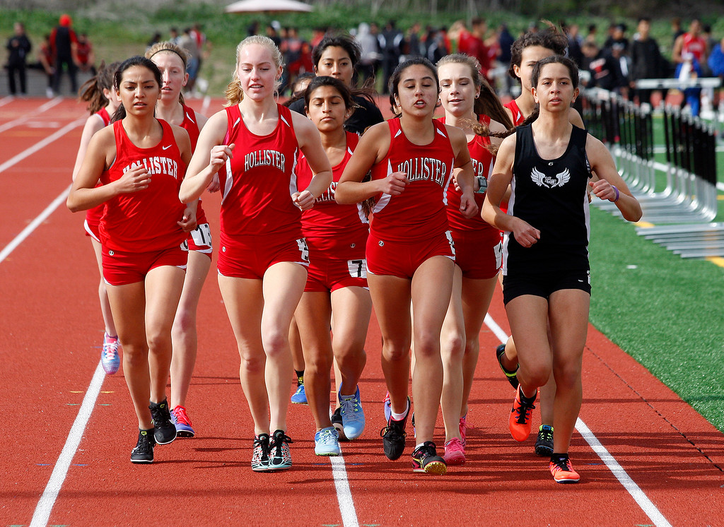 . North Monterey County High School\'s Sarah Delgado runs the mile race with a host of runners from San Benito High School during their meet in Castroville on Thursday, March 15, 2018.  (Vern Fisher - Monterey Herald)