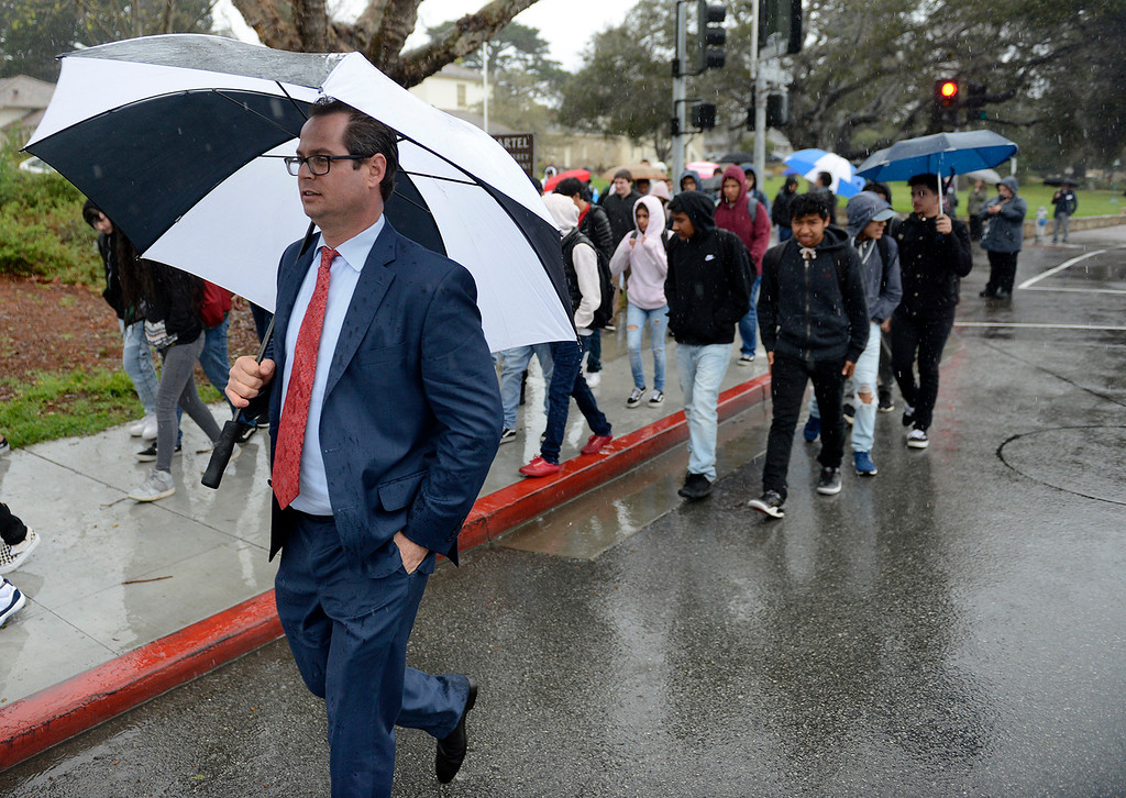 """. Monterey Peninsula Unified School District superintendent Daniel \""""PK\"""" Diffenbaugh walks with Monterey High School students during the National School Walkout Day on Wednesday, March 14, 2018.  (Vern Fisher - Monterey Herald)"""