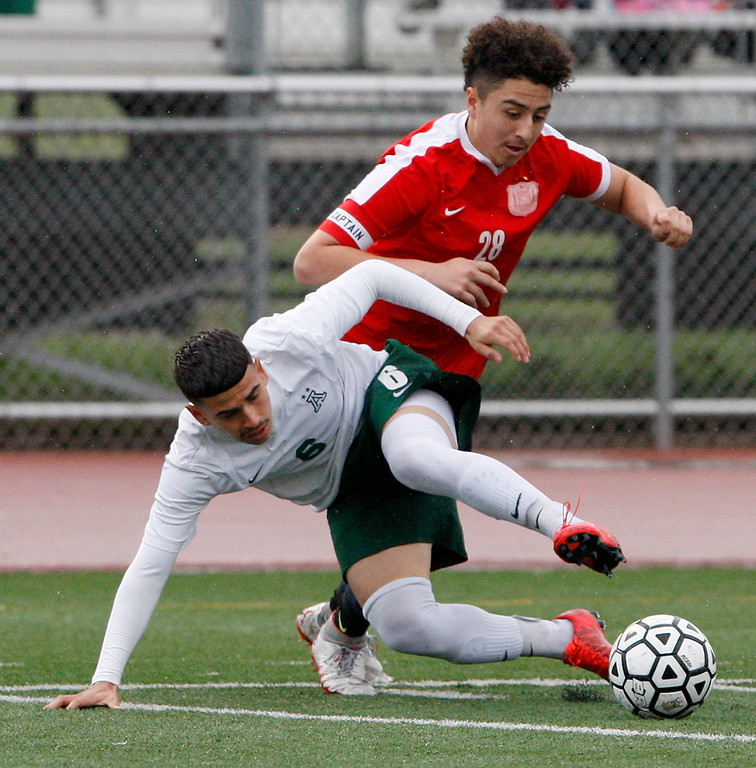 . Alisal High School\'s Angel Amezcua (6) battles Richmond High School\'s Manuel Nava (28) during their CIF Nor Cal DII Championship match in Salinas on Saturday, March 10, 2018.  Alisal went on to win the Nor Cal DII boys soccer title 3-1.  (Vern Fisher - Monterey Herald)