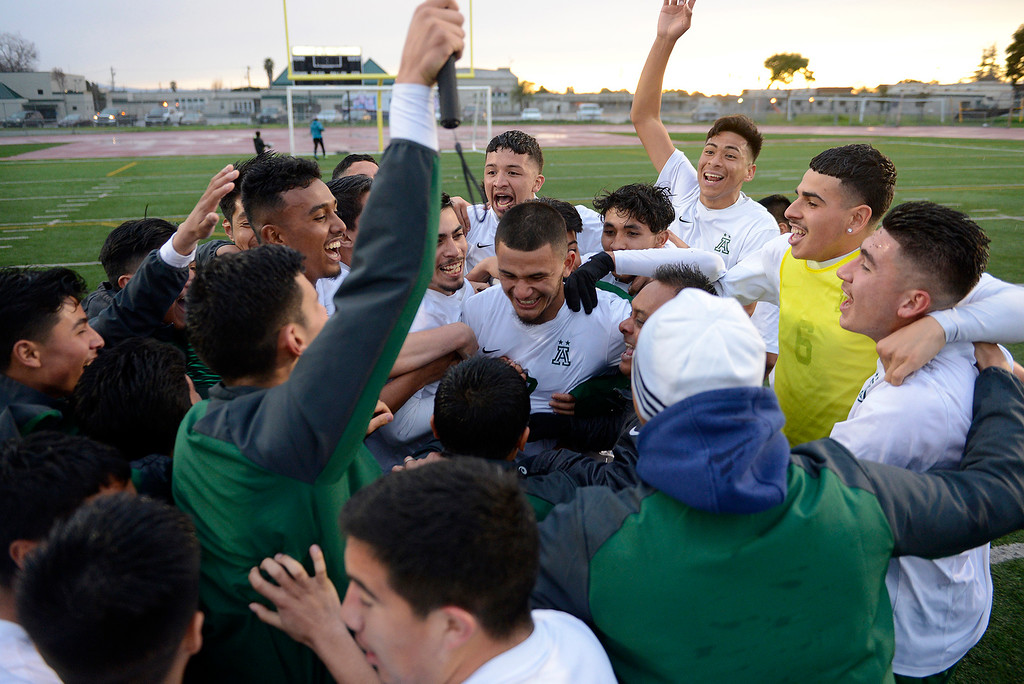 . Alisal High School celebrates their 3-1 win over Richmond High School in the CIF Nor Cal DII Championship match in Salinas on Saturday, March 10, 2018.   (Vern Fisher - Monterey Herald)
