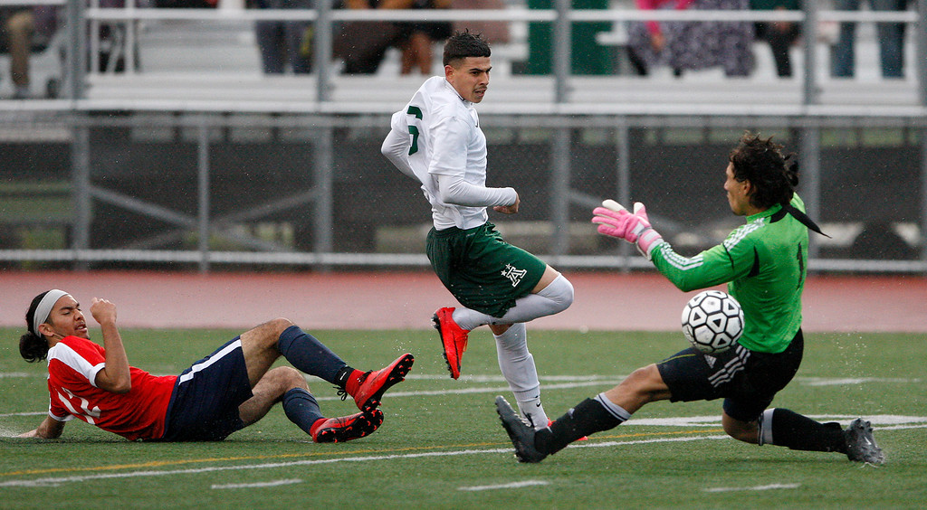 . Alisal High School\'s Angel Amezcua (6) gets past a defender and Richmond High School goalie Alejandro Rodriguez (1) for a goal during their CIF Nor Cal DII Championship match in Salinas on Saturday, March 10, 2018.  Alisal went on to win the Nor Cal DII boys soccer title 3-1.  (Vern Fisher - Monterey Herald)