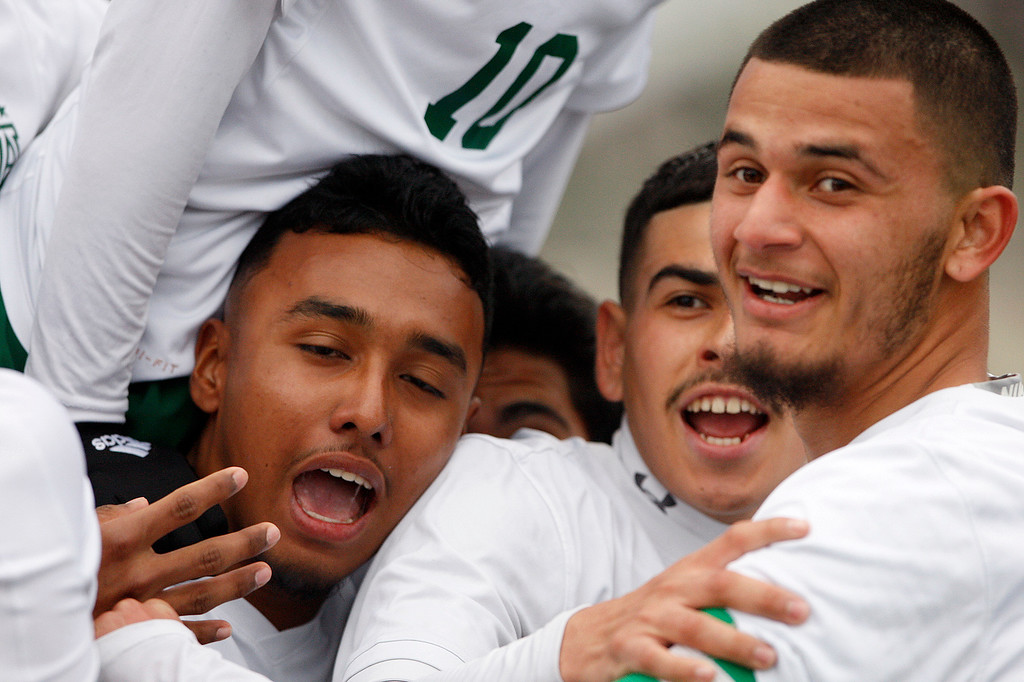 . Alisal High School players celebrate their 3-1 win over Richmond High School during their CIF Nor Cal DII Championship match in Salinas on Saturday, March 10, 2018.  Alisal went on to win the Nor Cal DII boys soccer title 3-1.  (Vern Fisher - Monterey Herald)
