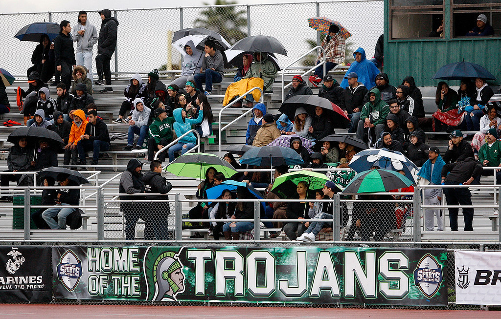 . Alisal High fans sit in the rain as Alisal High School battles Richmond High School during their CIF Nor Cal DII Championship match in Salinas on Saturday, March 10, 2018.  Alisal went on to win the Nor Cal DII boys soccer title 3-1.  (Vern Fisher - Monterey Herald)