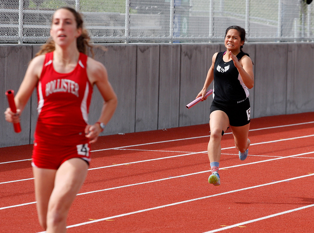 . North Monterey County High School\'s Nayla Anastacio runs the anchor leg of the girls 4x100 relay during their meet against San Benito High School on Thursday, March 15, 2018.  (Vern Fisher - Monterey Herald)