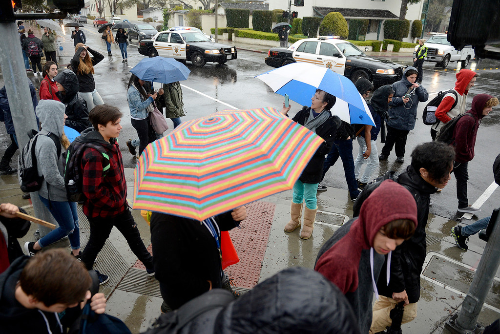 . Monterey police officers block the intersection at Pacific Street and Madison Street to allow students from Monterey High School to participate in the National School Walkout Day on Wednesday, March 14, 2018.  (Vern Fisher - Monterey Herald)