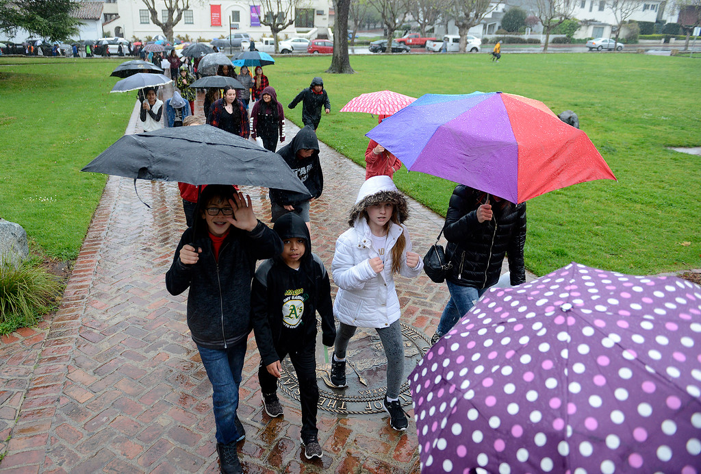 . Students from Bay View Academy walk to Colton Hall to meet with Monterey mayor Clyde Roberson as part of the National School Walkout Day on Wednesday, March 14, 2018.  (Vern Fisher - Monterey Herald)