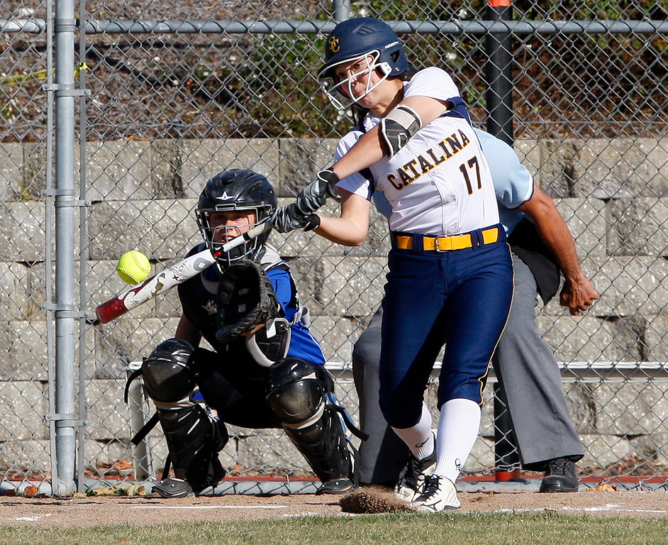 . Santa Catalina\'s Emily Hayes (17) gets a base hit during their game against South San Francisco High School in Monterey on Wednesday, May 16, 2018.  (Vern Fisher - Monterey Herald)
