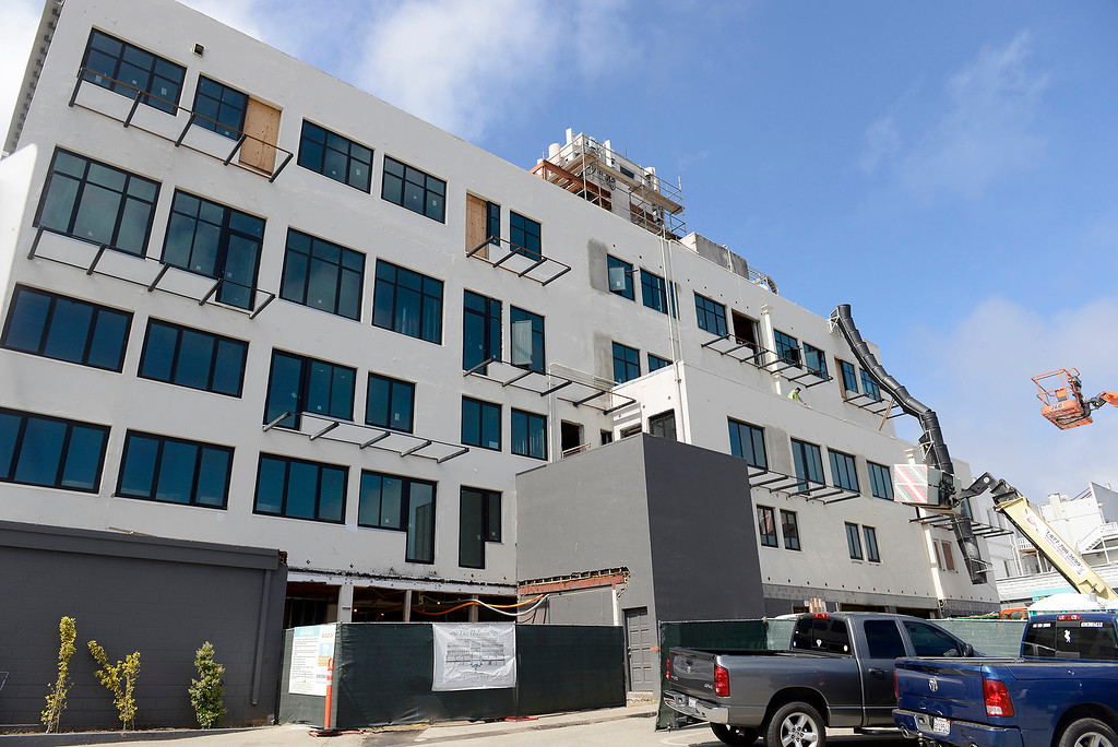 . Work continues on the Holman Building in Pacific Grove on Thursday, May 17, 2018.  (Vern Fisher - Monterey Herald)