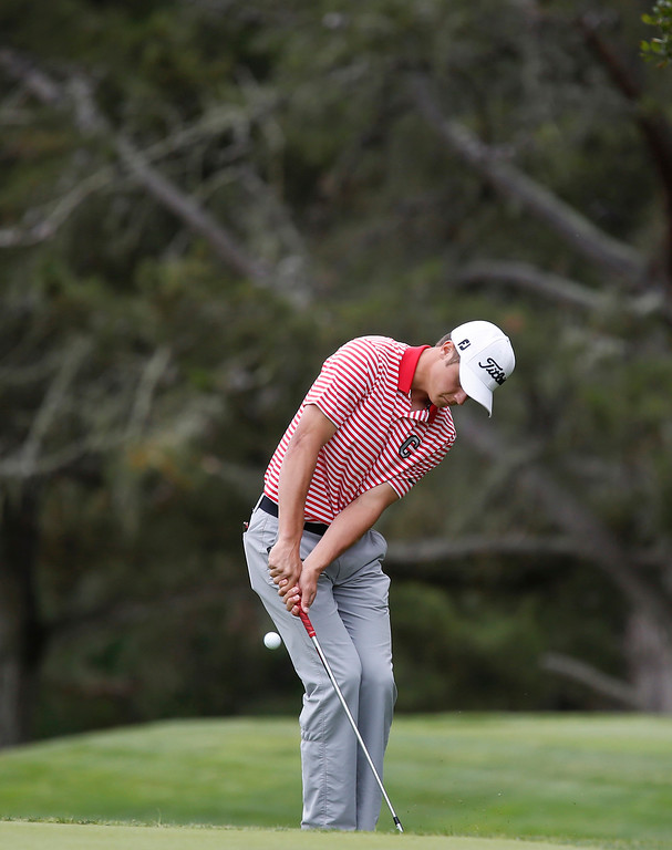 . Carmel\'s George McNeeley chips his ball onto the 11th green during the CCS Boys Golf Championship at Laguna Seca Golf Ranch in Monterey on Tuesday May 15, 2018. (David Royal/ Herald Correspondent)