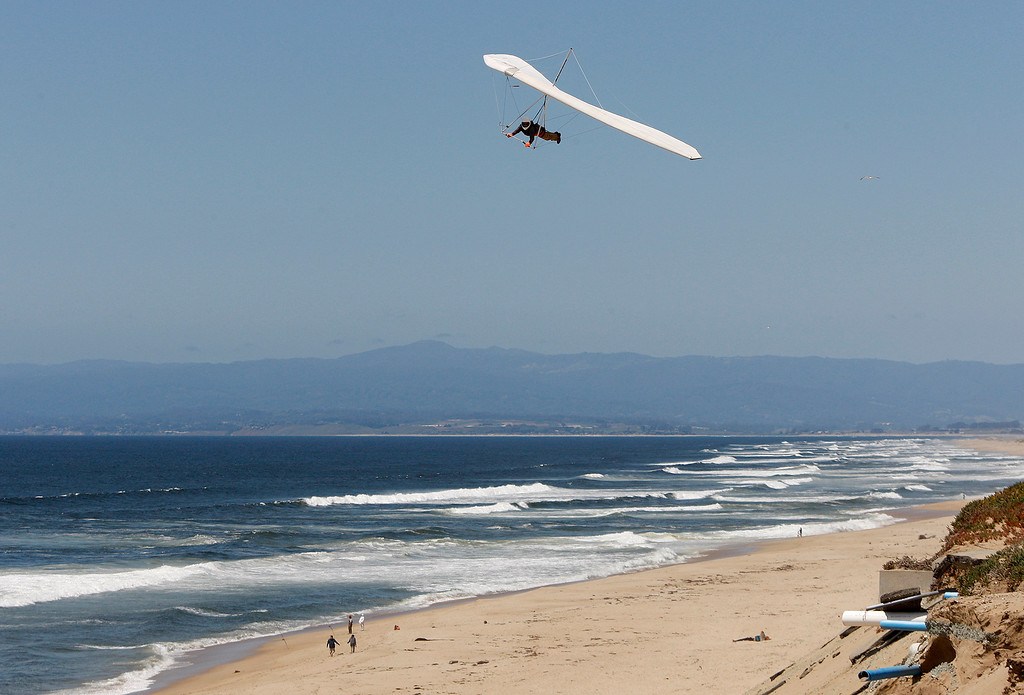 . A hang glider rides the wind over Marina State Beach on Monday, May 14, 2018.  (Vern Fisher - Monterey Herald)