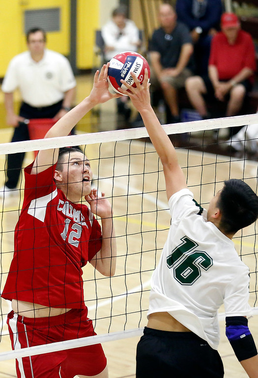 . Carmel\'s Aidan Westerman battles against  Harker\'s Billy Fan during the CCS boys volleyball championship at St. Francis in Mountain View on Saturday May 12, 2018. Carmel won the match 3-2. (David Royal/ Herald Correspondent)
