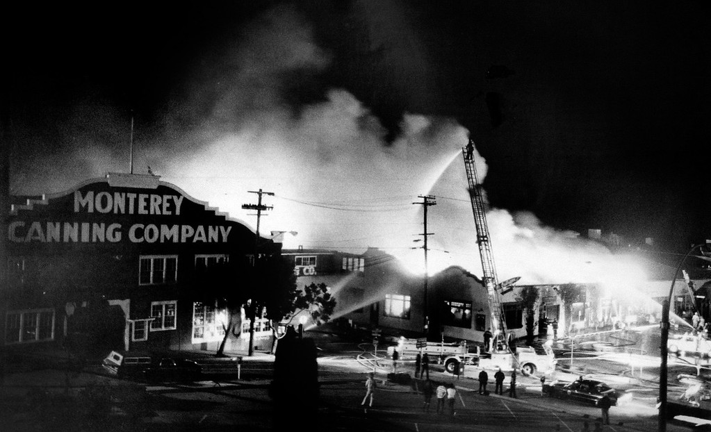 . A major fire on Cannery Row that originated at the Monterey Canning Company building on February 24, 1978, destroyed much of the building that included Sly McFly Bar and many other shops on what is now Steinbeck Plaza.  (Monterey County Herald rachives)