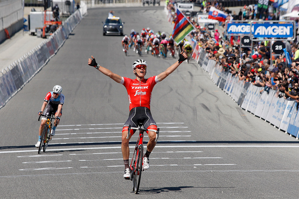 . Toms Skujins from Latvia raises his arms in victory as he rides across the Stage 3 finish at Laguna Seca Raceway in Monterey on Tuesday, May 15, 2018 during the Amgen Tour of California.  (Vern Fisher - Monterey Herald)