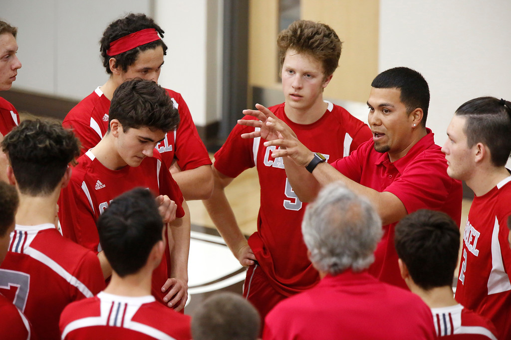 . Carmel\'s coach Israel Ricardez speaks with players during the CCS boys volleyball championship against  Harker at St. Francis in Mountain View on Saturday May 12, 2018. Carmel won the match 3-2. (David Royal/ Herald Correspondent)