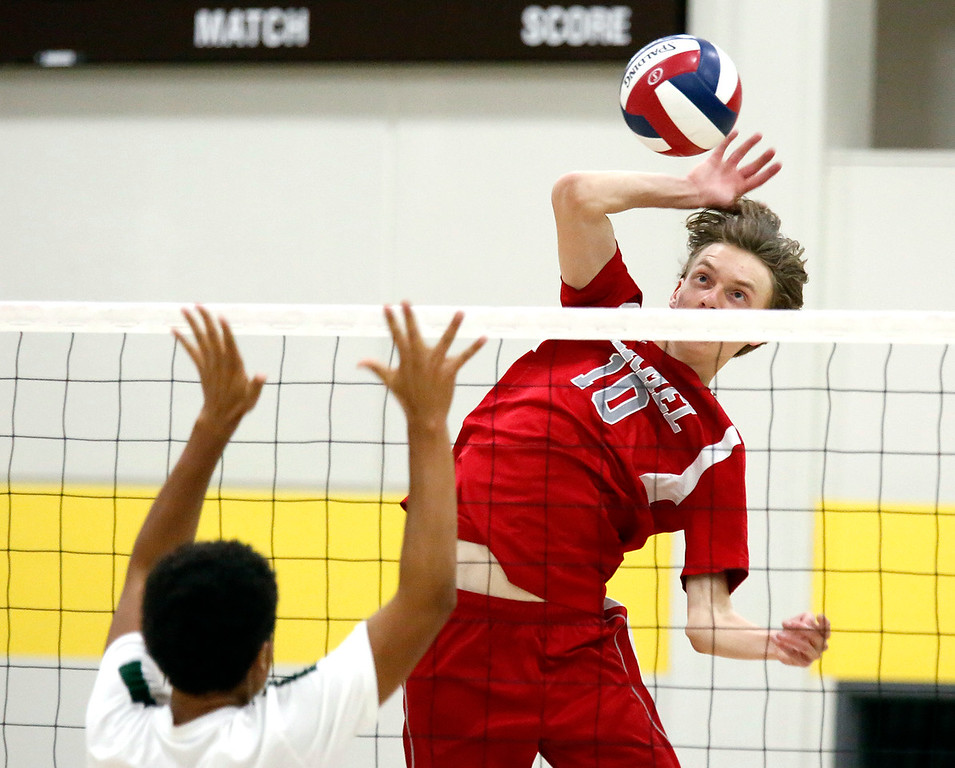. Carmel\'s Cole Dickman spikes a ball against  Harker during the CCS boys volleyball championship at St. Francis in Mountain View on Saturday May 12, 2018. Carmel won the match 3-2. (David Royal/ Herald Correspondent)