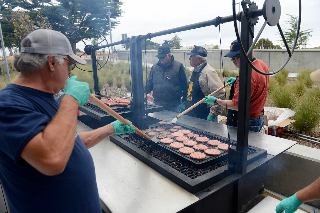 . Volunteers prepare the bbq at the Major General William H. Gourley VA-DoD Outpatient Clinic in Marina on Thursday, May 24, 2018.  (Vern Fisher - Monterey Herald)