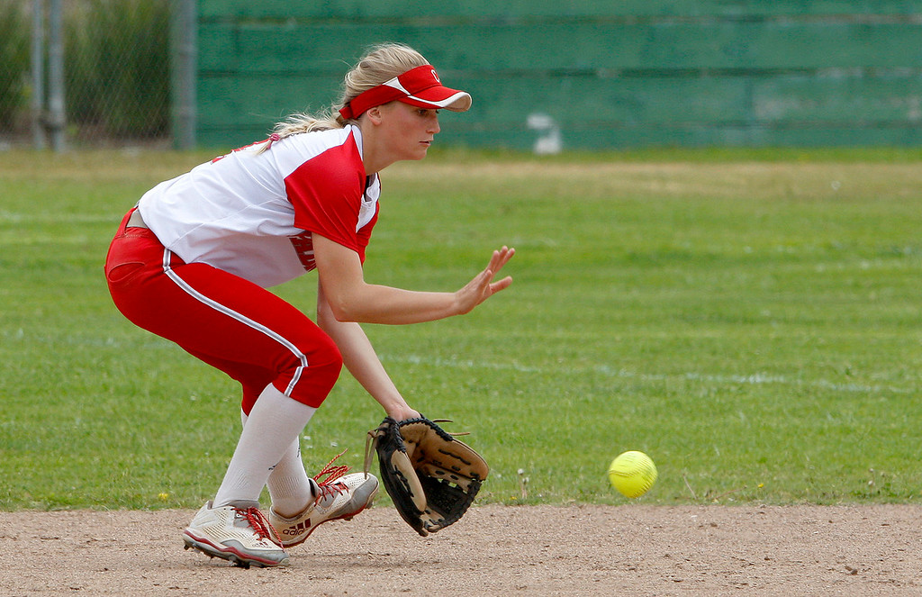 . Carmel High School\'s Rachael Carroll (14) fields a grounder at second base during their game with Pacific Grove High School during their CCS DII softball game in Salinas on Saturday, May 19, 2018.  (Vern Fisher - Monterey Herald)