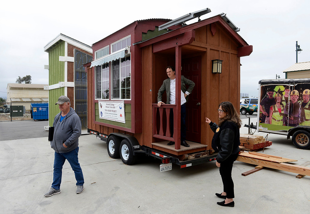 . Bill Kelley, Thomas Rettenwender, Jennifer Suttie at the Hartnel College Alisal campus on Monday, May 21, 2018 with an example of a tiny house model that the Veterans Transition Center in Marina will use in a tiny house village.  (Vern Fisher - Monterey Herald)