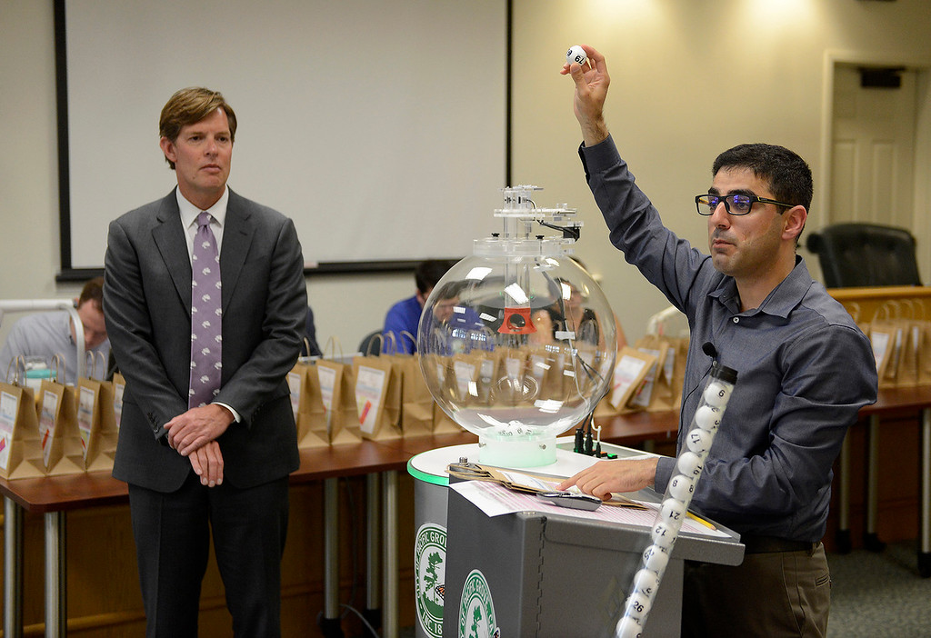 . Pacific Grove city manager Ben Harvey and city employee Haroon Noori at a special meeting on Tuesday, May 22, 2018 for a lottery to determine restrictions on short-term rental properties.  (Vern Fisher - Monterey Herald)