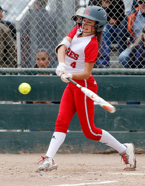 . Carmel High School\'s Quinci Cox (4) makes contact at the plate during their game with Pacific Grove High School during their CCS DII softball game in Salinas on Saturday, May 19, 2018.  (Vern Fisher - Monterey Herald)