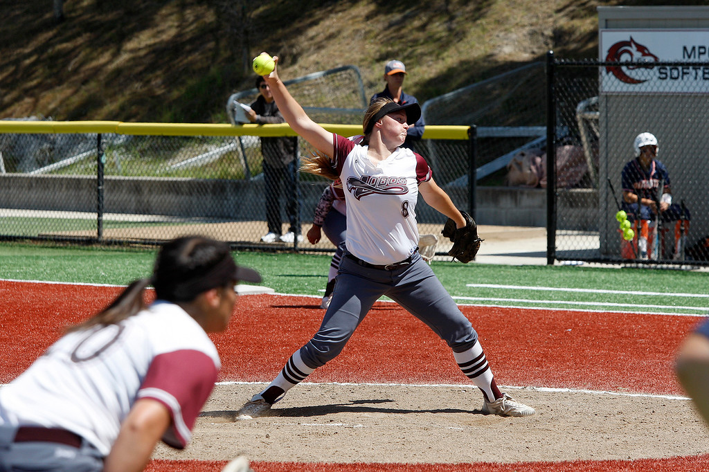 . Monterey Peninsula College\'s Sally Bowles (8) delivers a pitch in the second inning during their game against College of the Sequoias on Friday, May 4, 2018.  (Vern Fisher - Monterey Herald)