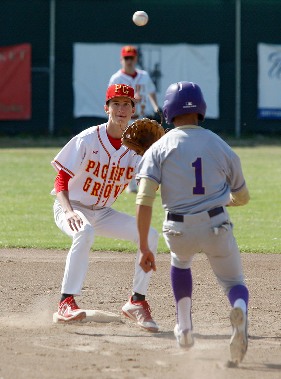 . Pacific Grove High School\'s Jackson Destefano (4) is late with the tag as Soledad High School\'s Andru Holguin (1) makes it safely into second base during their game in Pacific Grove on Thursday, May 10, 2018.  (Vern Fisher - Monterey Herald)