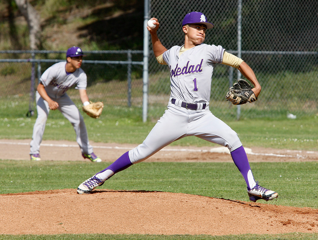 . Soledad High School\'s Andru Holguin (1) delivers a pitch during their game against Pacific Grove High School in Pacific Grove on Thursday, May 10, 2018.  (Vern Fisher - Monterey Herald)