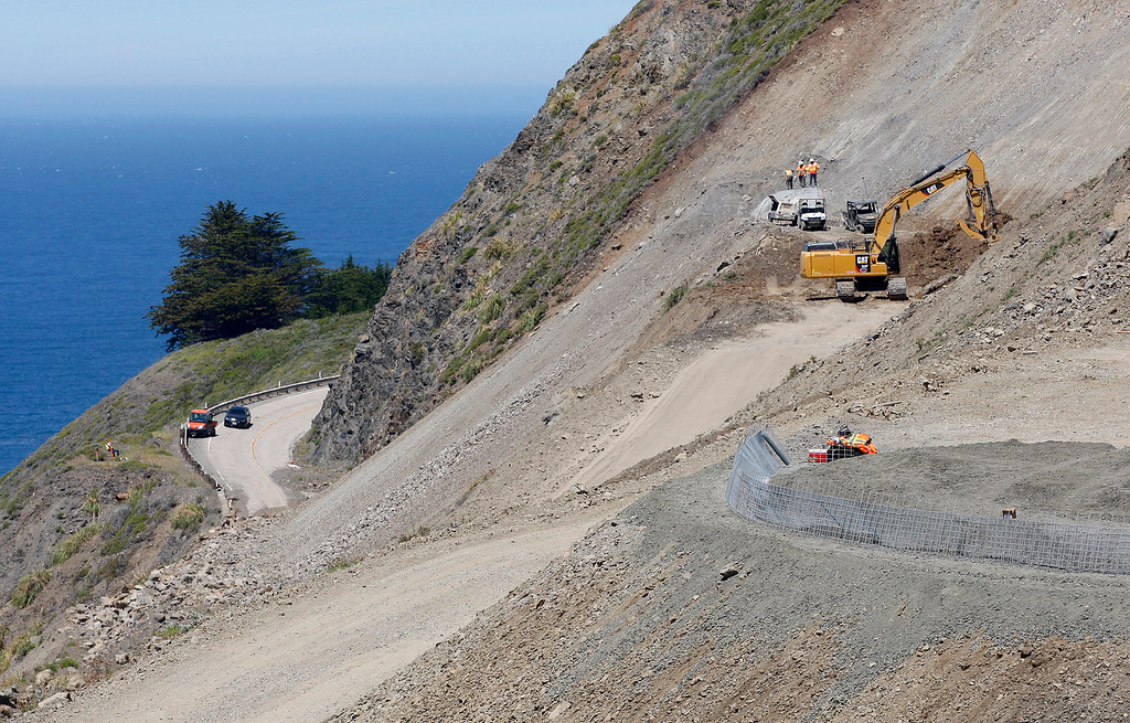 . Looking north from the Mud Creek slide at Highway One as Cal Trans crew prepare to blast a problem boulder upslope of the roadway on Monday, May 7, 2018.  (Vern Fisher - Monterey Herald)