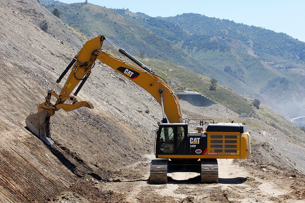 . Heavy machine work continues at the Mud Creek slide on Highway One south of Big Sur on Monday, May 7, 2018.  (Vern Fisher - Monterey Herald)