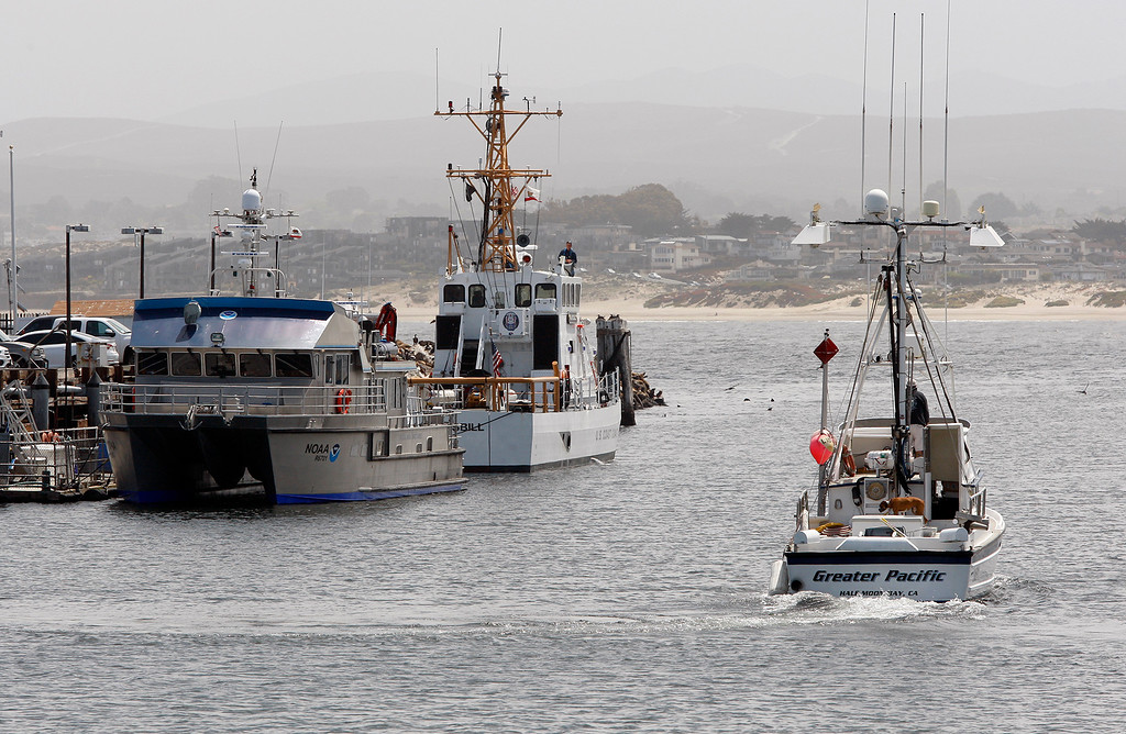 . The National Marine Sanctuary Program\'s 67-foot R/V Fulmar and the 87-foot Coast Guard Cutter Hawksbill tied to the U.S. Coast Guard Pier in Monterey on Thursday, May 10, 2018.  (Vern Fisher - Monterey Herald)