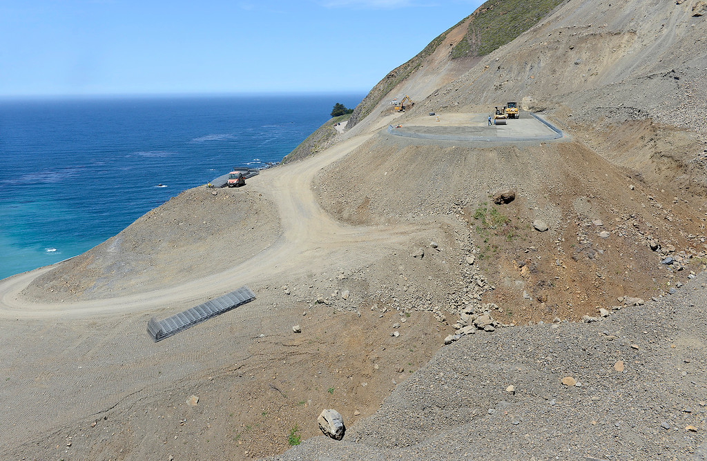 . Hilfiker retaining walls being constucted upslope of the Highway One road deck that will funnel future debris at the Mud Creek slide on Monday, May 7, 2018.  (Vern Fisher - Monterey Herald)